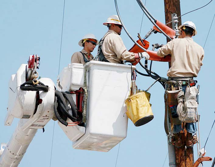Utility workers repairing a power line