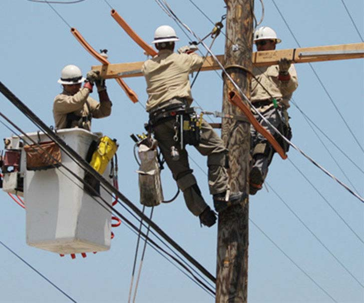 Linemen working on transmission line