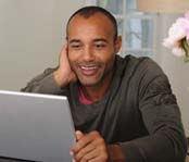 Man looking at a laptop