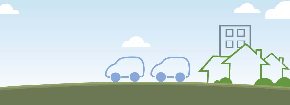Illustration of two cars, three houses and a building