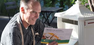 Man reading a booklet or brochure
