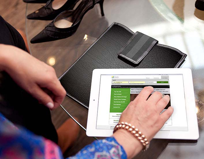 Woman looking up EV tools and resources on an iPad