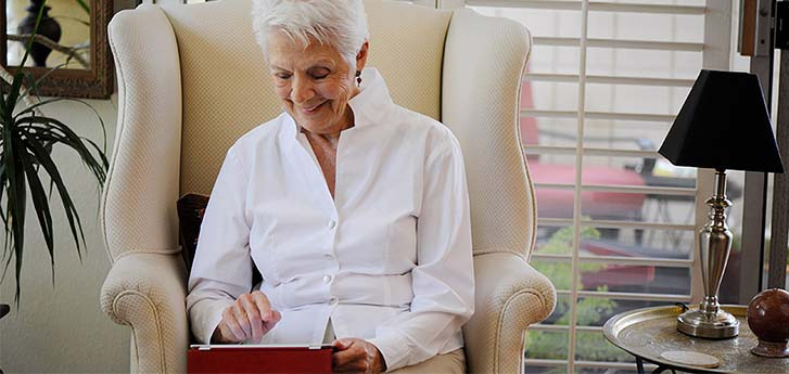 Senior Woman checking her bill on an iPad