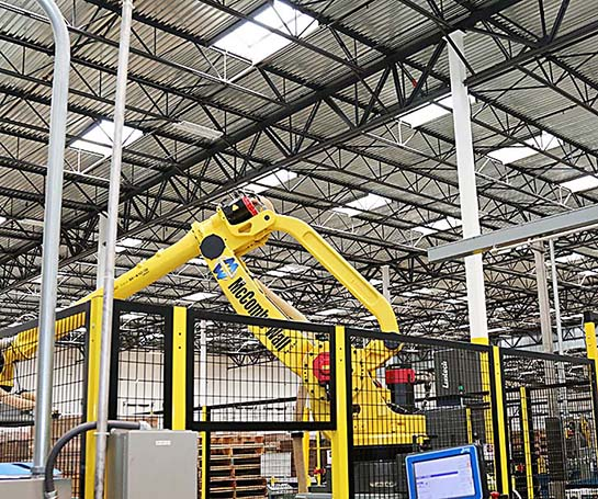 Image of interior of factory with robotic arm